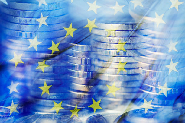 euro coins and the flag of the European Union stock photo