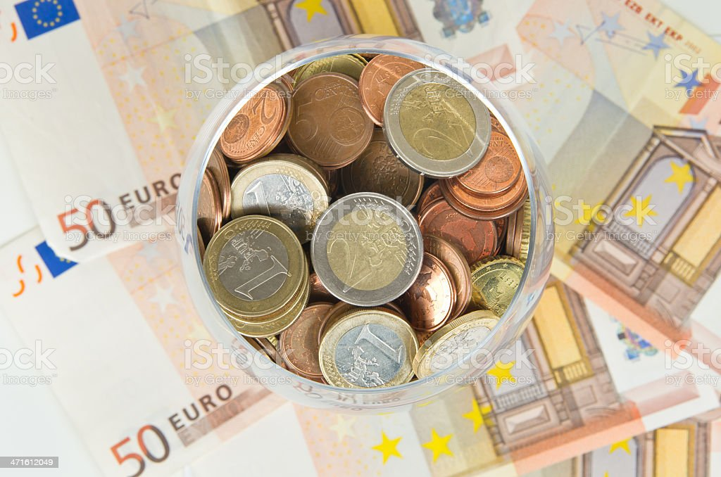 Euro coins in glass royalty-free stock photo