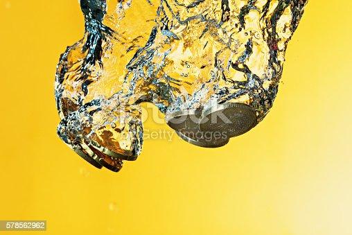 istock Euro coins in water splash 578562962