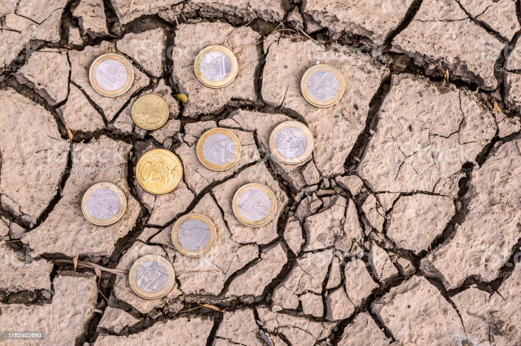 Euro coins on dry ground. - Royalty-free Accidents and Disasters Stock Photo