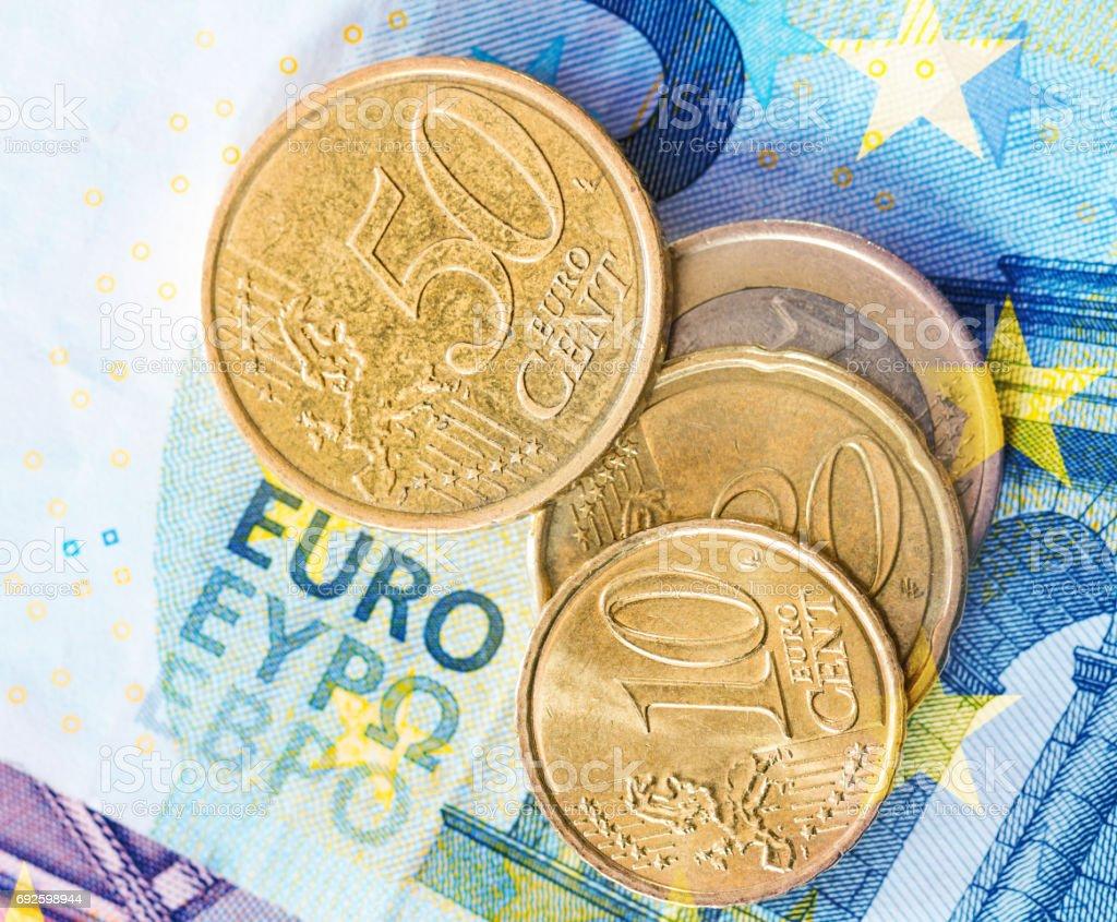 euro coins on euro banknotes background stock photo