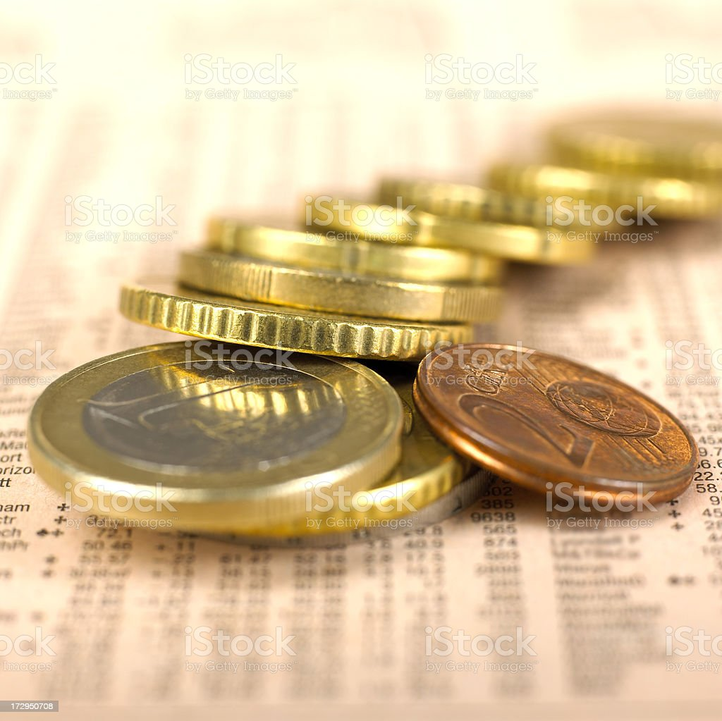 Euro coins on financial newspaper royalty-free stock photo