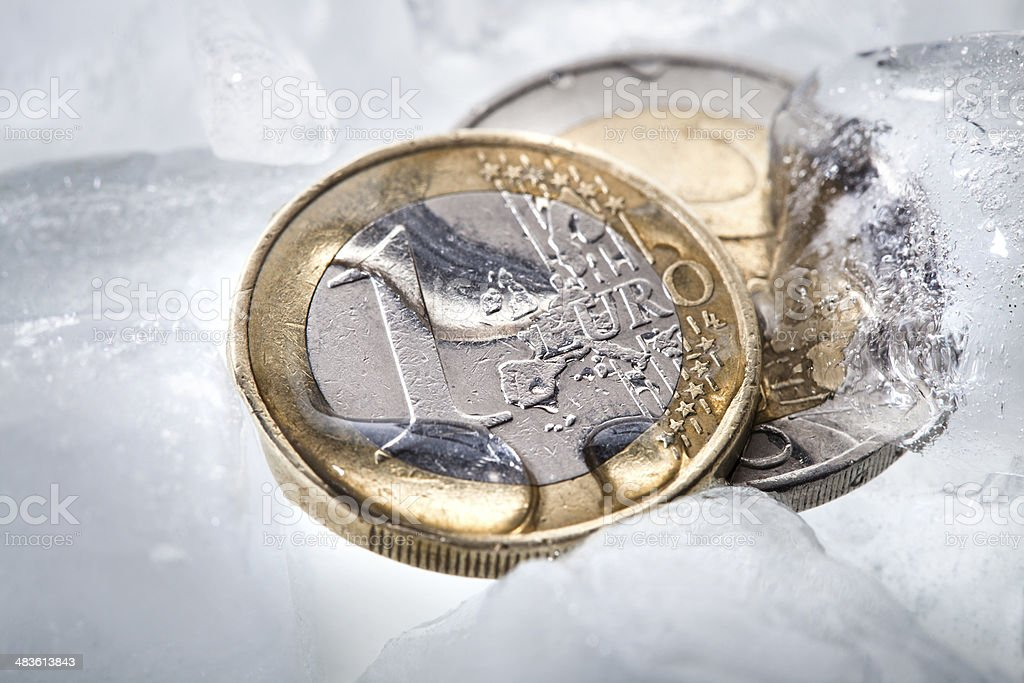 Euro coins on ice stock photo