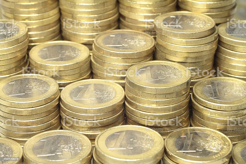 Euro coins About 300 Euro coins lie on a stack. Cent Sign Stock Photo
