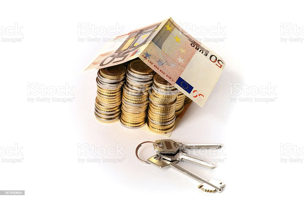 Euro Coins pile House with banknote roof and key royalty-free stock photo