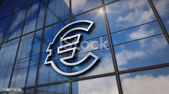 Euro EU currency symbol on glass building. Mirrored sky and city on modern facade. Finance,European Union, banking and money sign concept 3D rendering illustration.