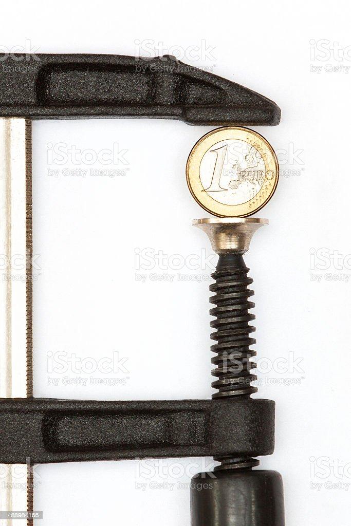 Euro in clamp stock photo