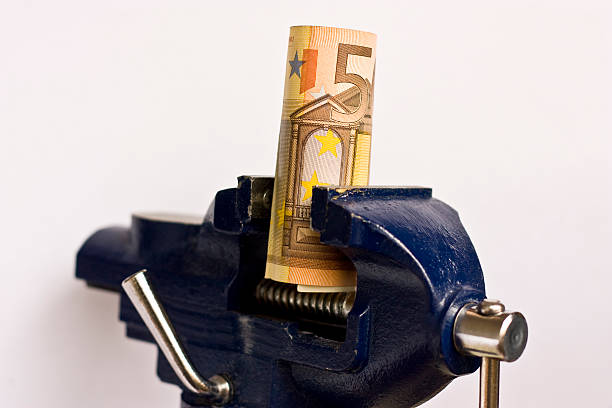 Euro in the clamp schoke stock photo