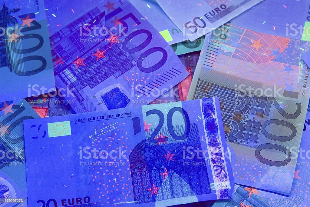 euro in uv light protection stock photo