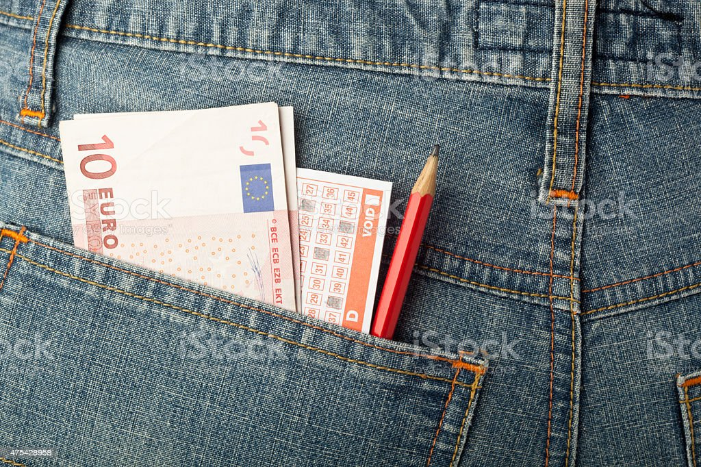 Euro money and lottery bet slip in pocket stock photo