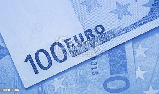istock Euro money close-up blue abstract background 882817600