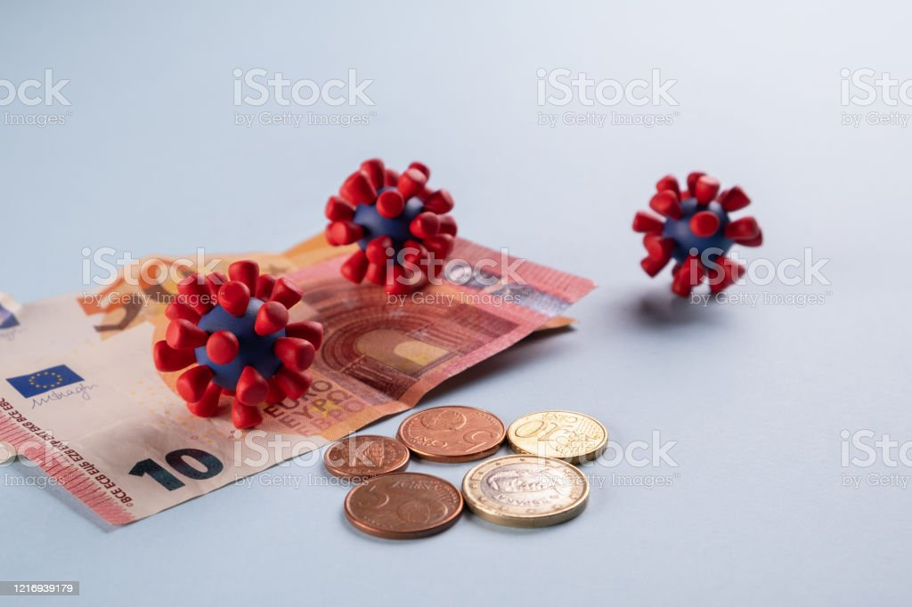 Euro money, coins and models of covid-19 virus on blue background Contaminated infected cash money. Economy crisis Euro money, coins and models of covid-19 virus on blue background Contaminated infected cash money. Economy crisis Backgrounds Stock Photo