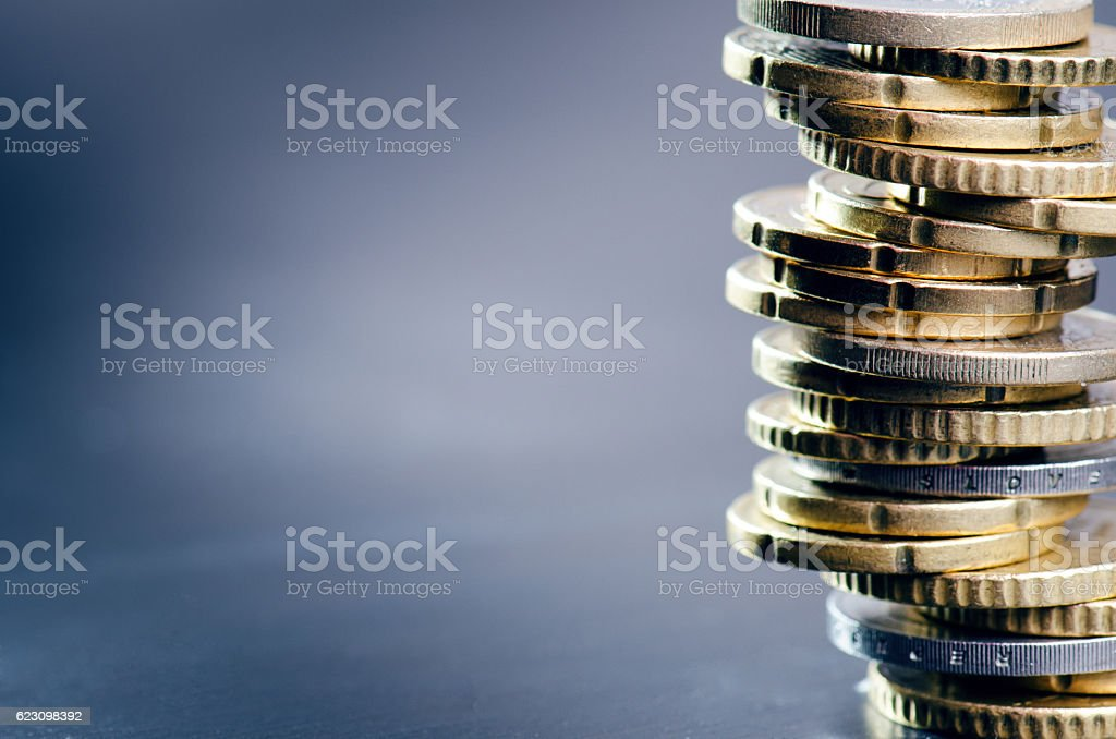 Euro money. Coins are isolated on a dark background. stock photo