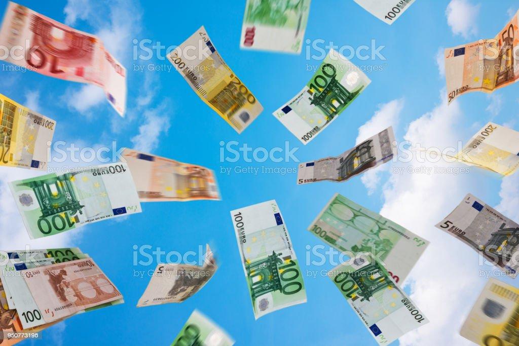 Euro money fallig down on the sky cimposite image Business Stock Photo