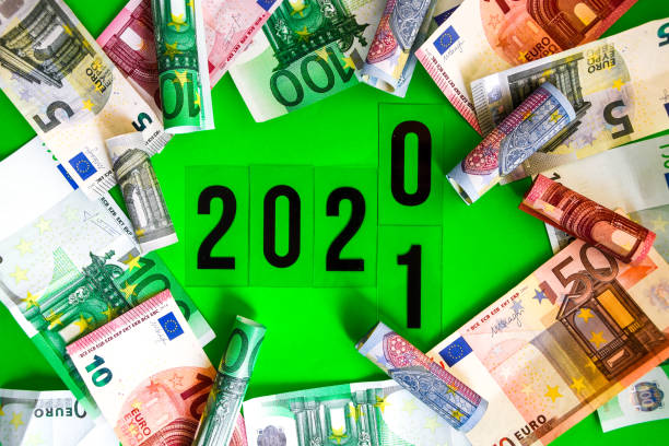 Euro Money Frame with 2020 change into 2021 word inside on green background stock photo