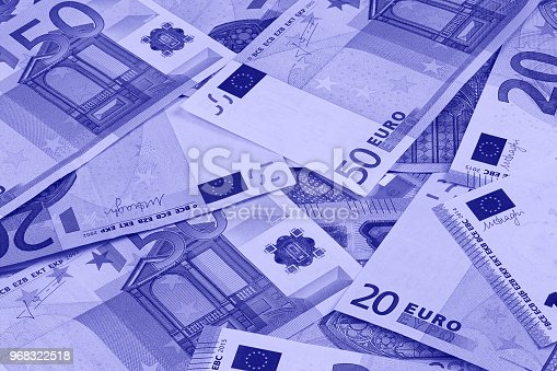 istock Euro money of different denominations duotone abstract background. 968322518