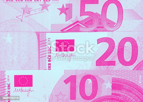 istock Euro money of different denominations duotone abstract background. 968326018