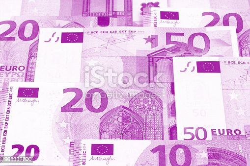 istock Euro money of different denominations duotone abstract background. 968332700