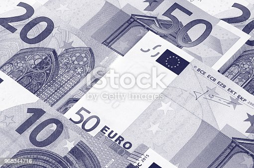 istock Euro money of different denominations duotone abstract background. 968344716