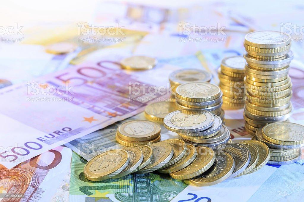 euro money stacks and bills stock photo