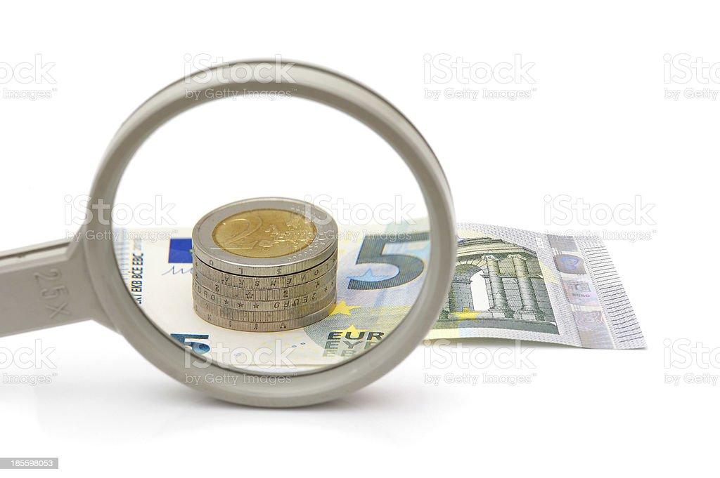 Euro money under magnifying glass stock photo