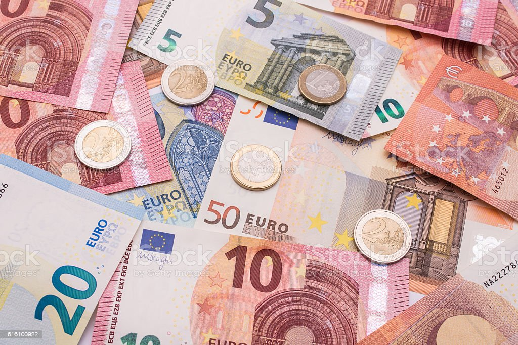 Euro notes and coins stock photo