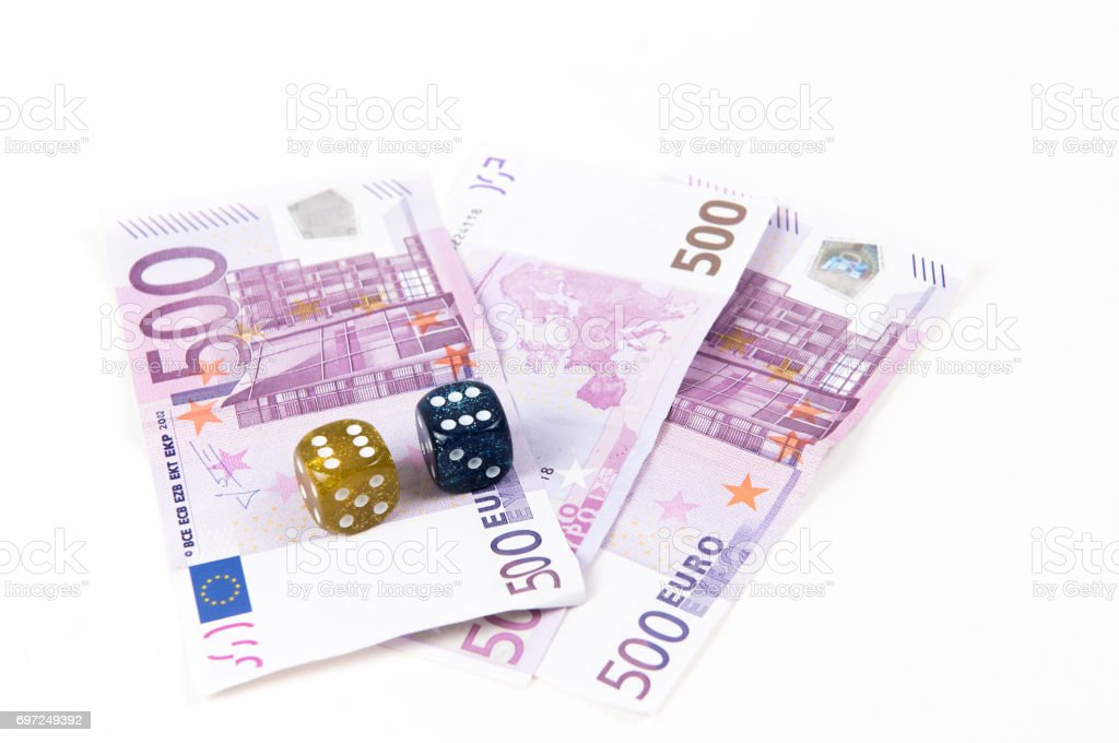 Euro notes and dice stock photo