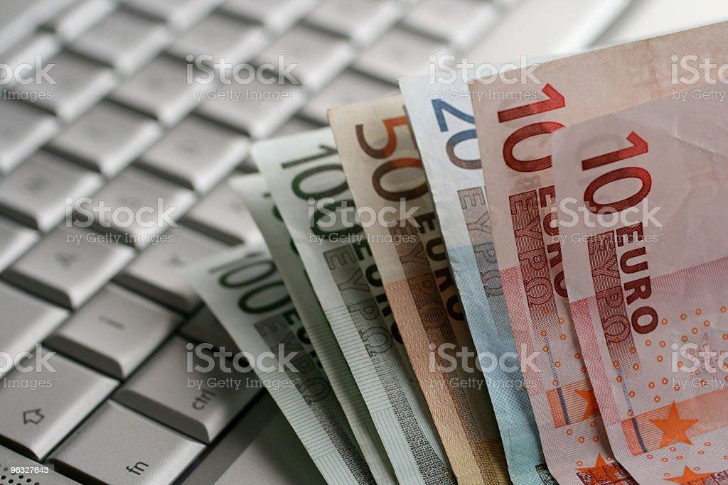 Euro notes on a laptop royalty-free stock photo