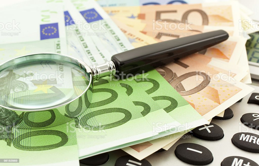 Euro Notes with calculator and magnifier royalty-free stock photo