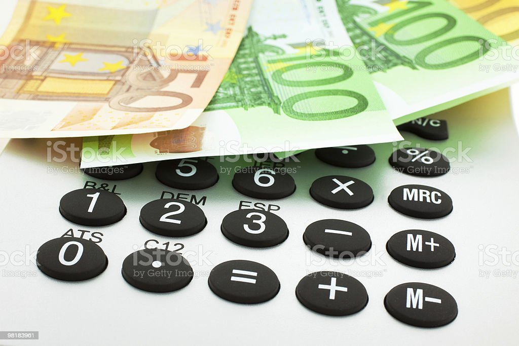 Euro notes with calculator royalty-free stock photo