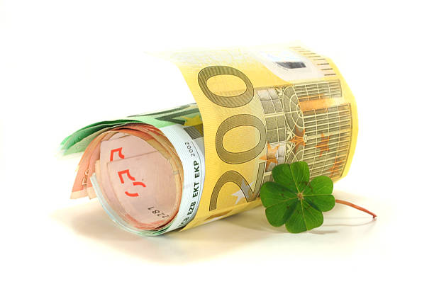 Euro notes with Clover stock photo