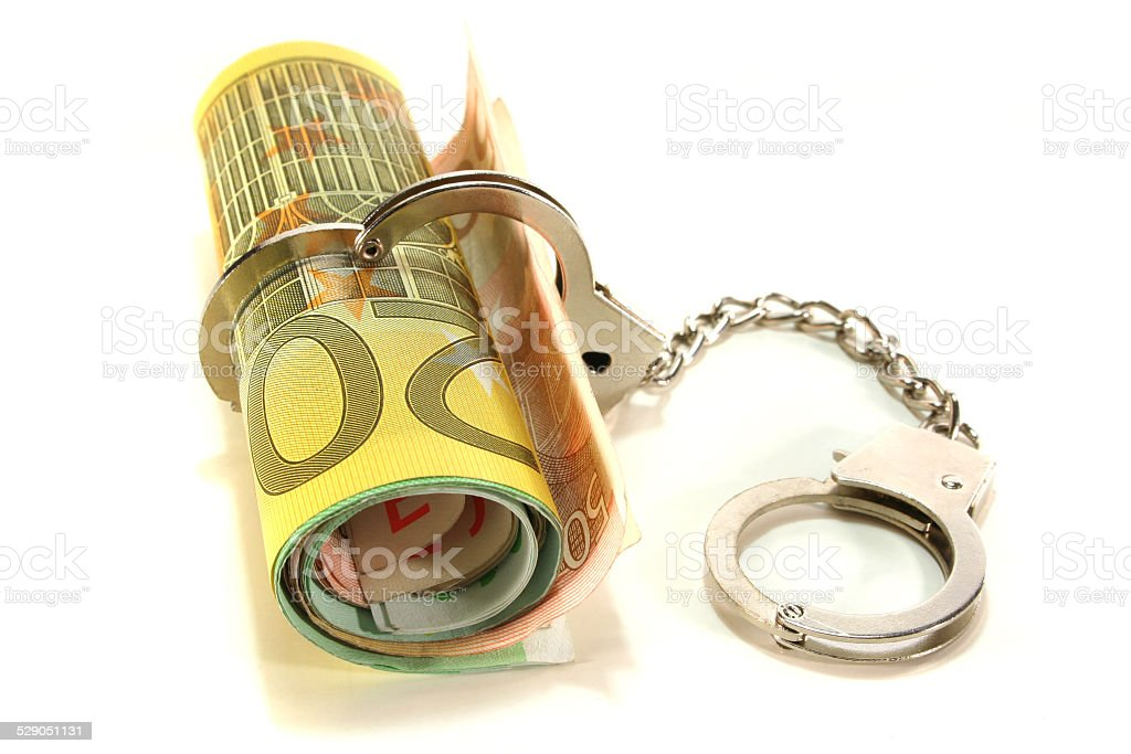 Euro notes with handcuffs stock photo