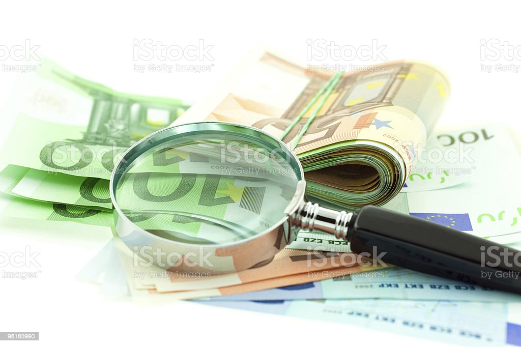 euro notes with magnifier on white background royalty-free stock photo
