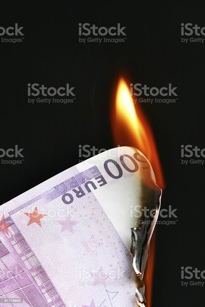Euro on fire stock photo
