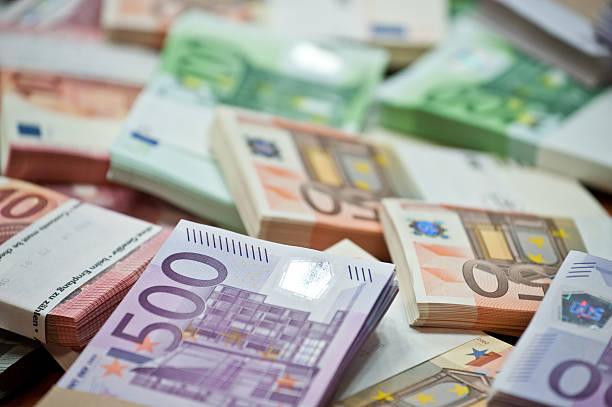 euro lots of euro bills on the table european union currency stock pictures, royalty-free photos & images