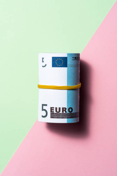 Euro roll on two tone color background stock photo