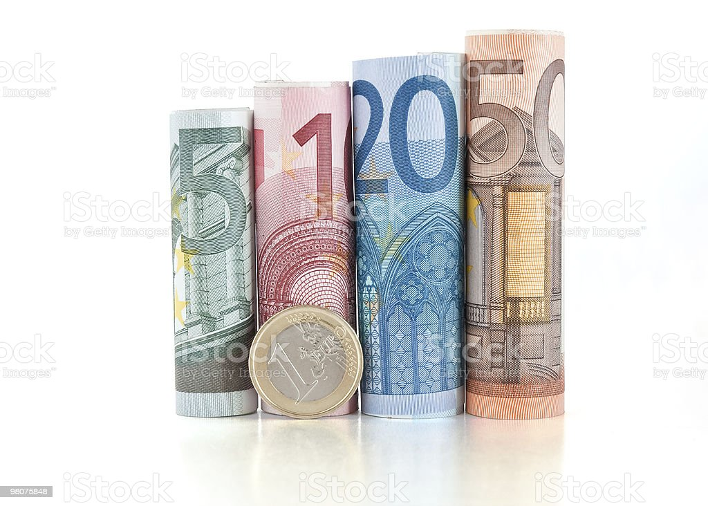euro rolled bills and coin stock photo
