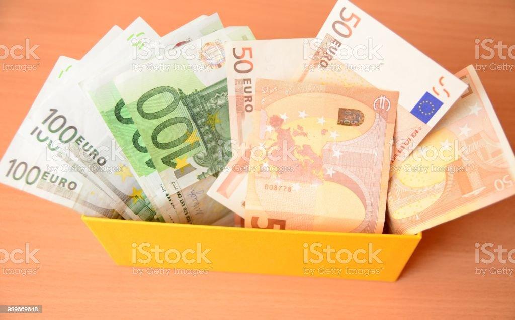 Euro savings in yellow box stock photo