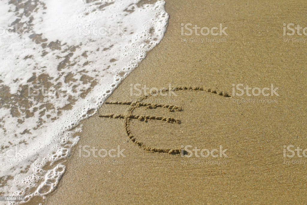 Euro sign on the beach royalty-free stock photo