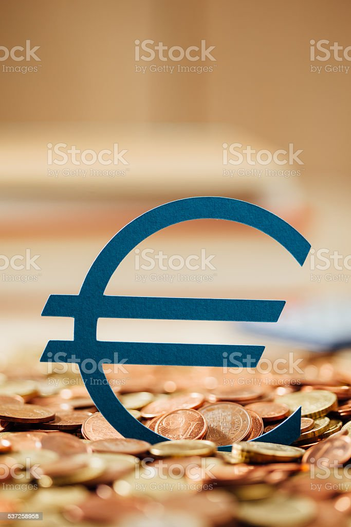 Euro symbol and coins stock photo