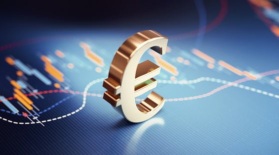Euro symbol sitting over blue financial bar graph. Selective focus. Horizontal composition with copy space. Stock market and finance concept.