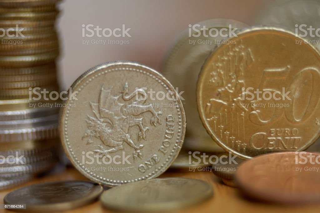 50 eurocent and one pound coins on the table stock photo