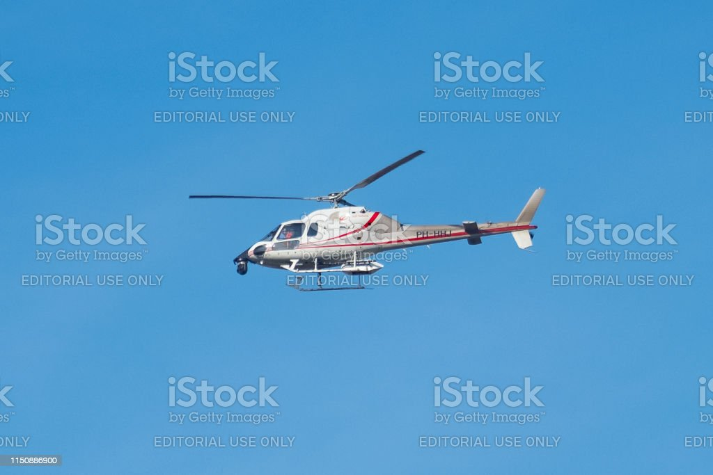 Eurocopter AS 355 F2 Ecureuil 2 flying in mid air during a beautiful...