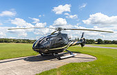Eurocopter EC130B4 on hard standing at grass airfield