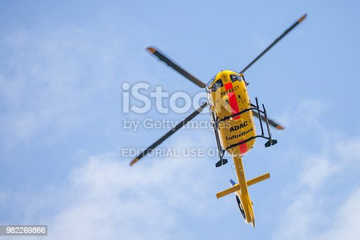istock Eurocopter EC-135 from ADAC Luftrettung flies over landing side. Notarzt means emergency doctor. 982269866