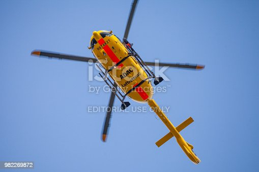 istock Eurocopter EC-135 from ADAC Luftrettung flies over landing side. Notarzt means emergency doctor. 982269872