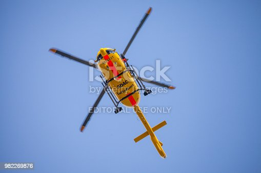 istock Eurocopter EC-135 from ADAC Luftrettung flies over landing side. Notarzt means emergency doctor. 982269876
