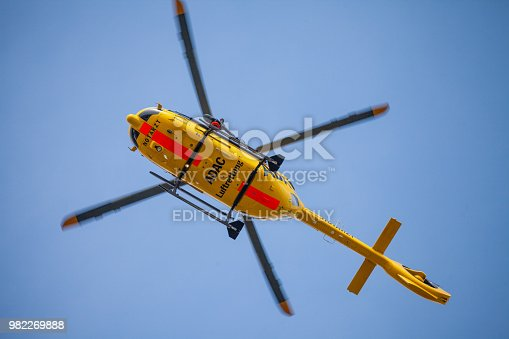 istock Eurocopter EC-135 from ADAC Luftrettung flies over landing side. Notarzt means emergency doctor. 982269888