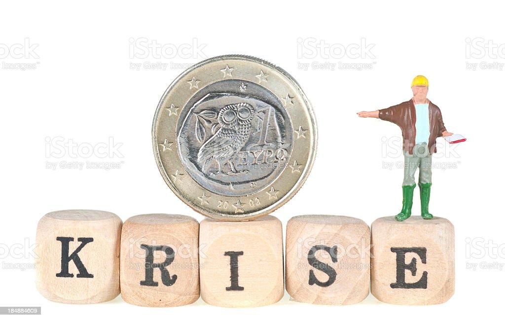 Eurokrise Wort mit griechischer Euromünze und Männchen abstrakt royalty-free stock photo