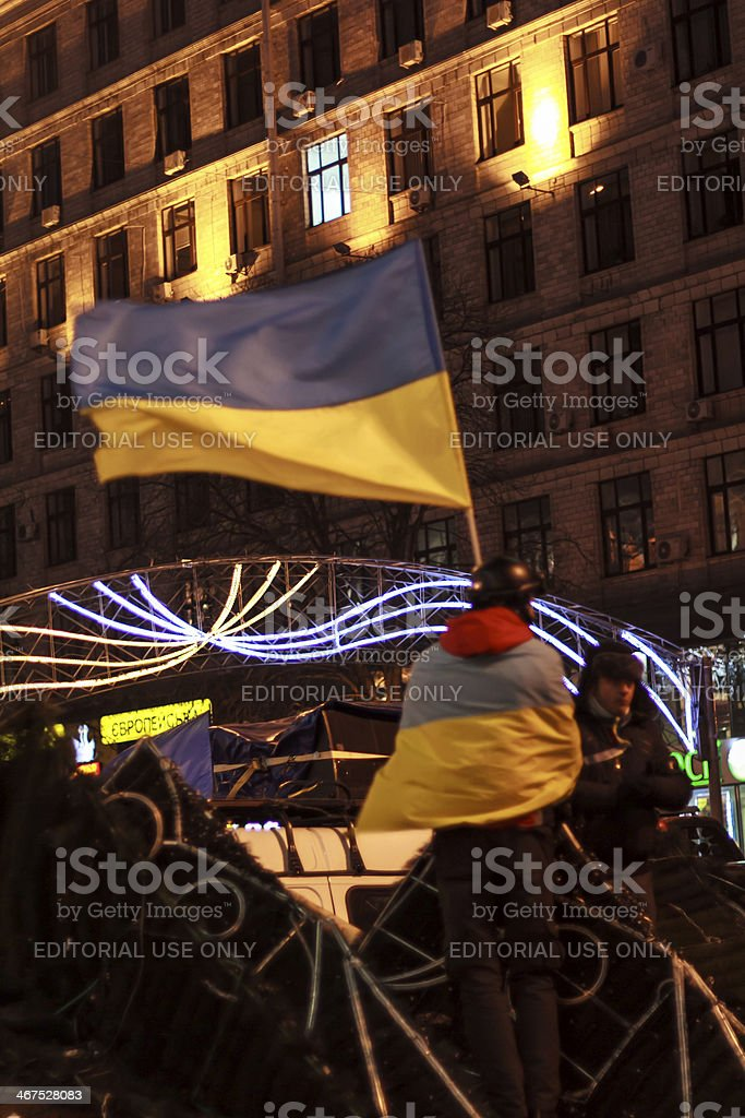 Euromaidan protester with flag stands on the barricades royalty-free stock photo